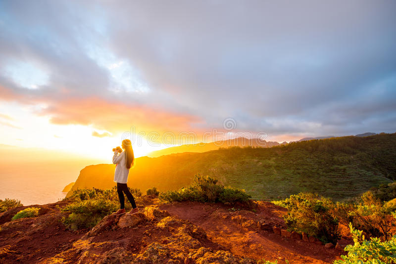 Mountain sunrise view on La Gomera island. Beautiful landscape view near mirador de Abrante on La Gomera island with woman enjoying the sunrise royalty free stock photography