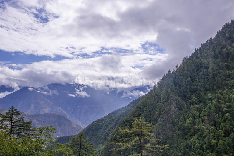 Mountain surrounded by cloud at dawn landscape in Shangri La, Yunnan Province, China royalty free stock photography