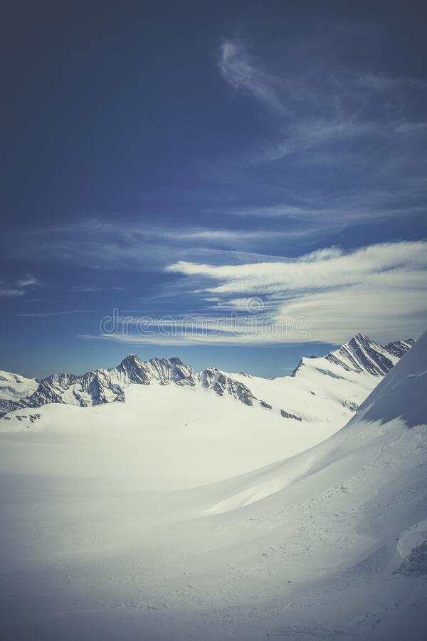 Mountain Surrounded by Snow Under Blue Sky stock image