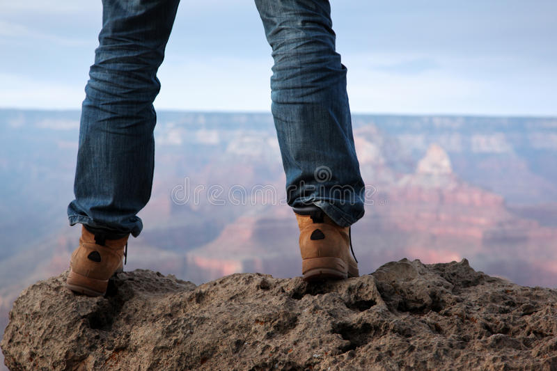 Mountain top cliff standing royalty free stock photo