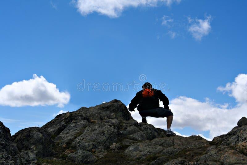 Mountain top hiker royalty free stock photo