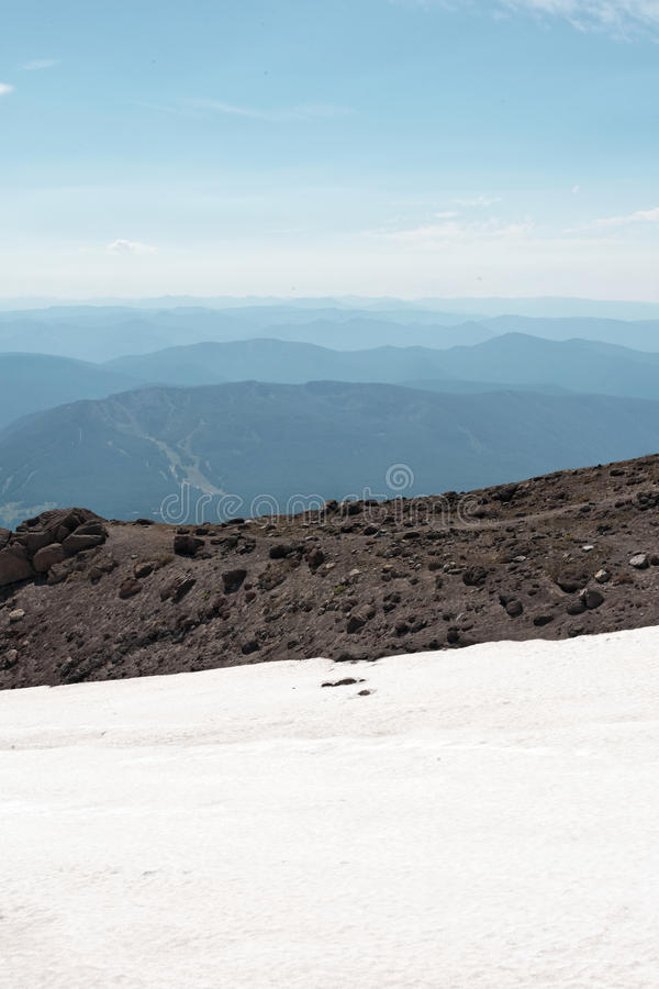 Mountain top landscape ranges in distance royalty free stock photography