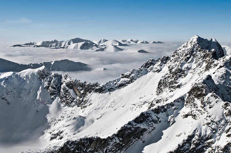 Mountain tops. In winter. taken with nikon d300 camera with 24-70 2,8 sigma lens in raw file stock photos
