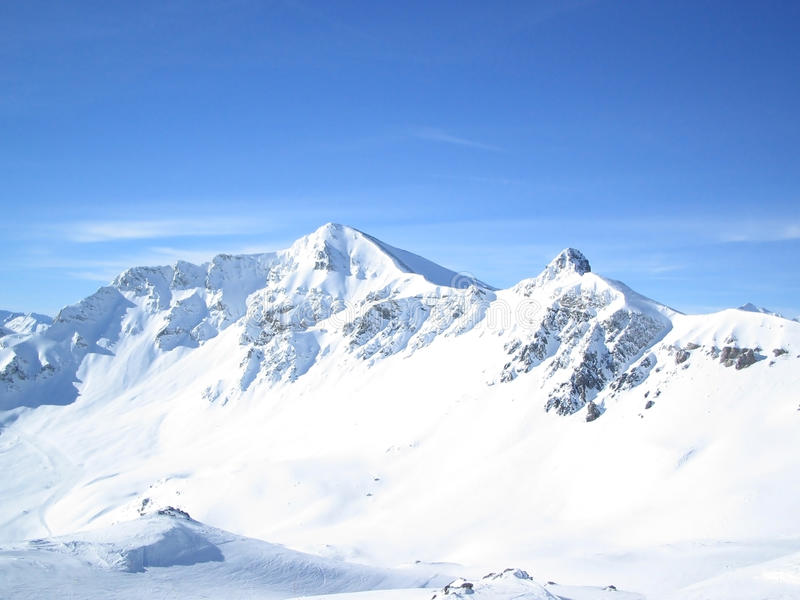 Mountain Tops. Swiss Mountain Tops in Winter under blue sky royalty free stock images