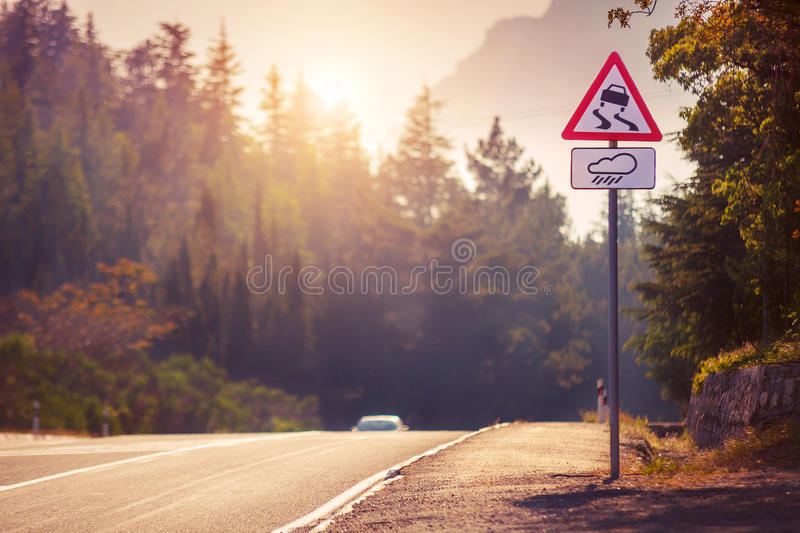 Mountain tortuous road in sunset time stock image