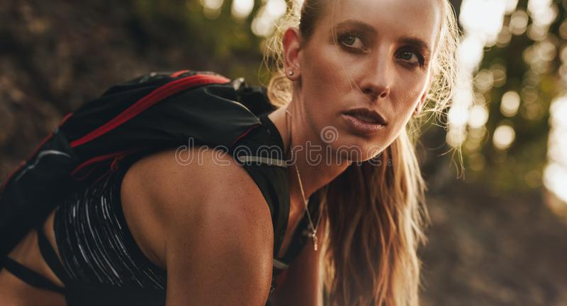 Mountain trail runner resting after a run stock photo