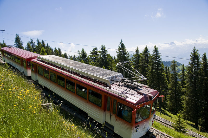Mountain train. Train shuttle transporting people up and down a high mountain in heart of Switzerland stock photos