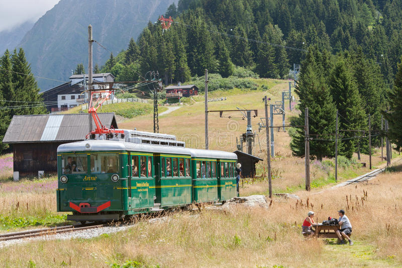 The mountain tram Anna runs from Saint-Gervais-les-B to the Nid d'Aigle station, France. LES HOUCHES, FRANCE - JUL 27, 2015: The mountain tram Anna runs from stock images