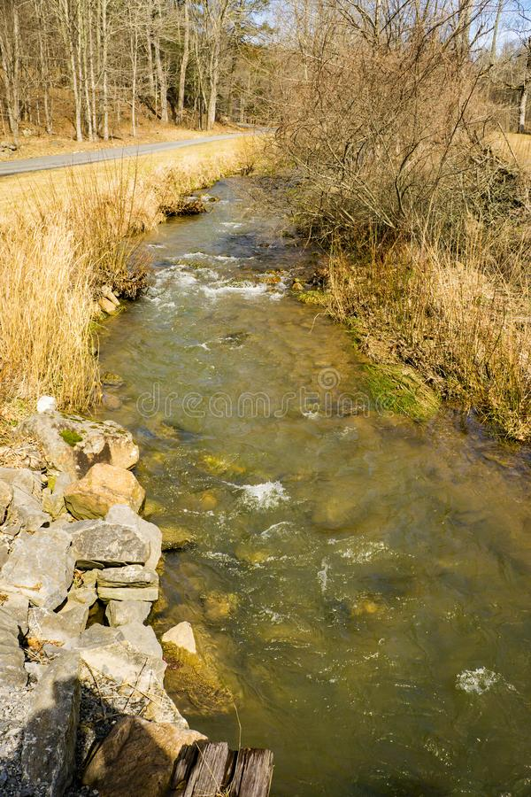 A Mountain Trout Stream. Wild mountain trout stream located by a county road in Highland County, Virginia, USA stock image