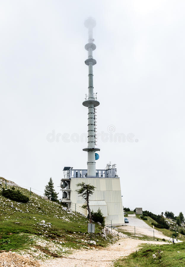 Mountain TV and radio transmitter telecommunication tower antenna Krvavec, Slovenia. royalty free stock images