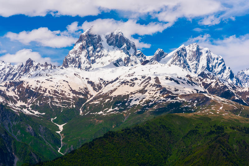 Mountain Ushba. In the center, 4690 m, and the surroundings. Svaneti region, Georgia. Ushba known as the `Matterhorn of the Caucasus` for its scenic, spire royalty free stock images