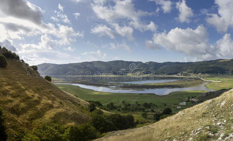 Mountain valley and lake. In matese park stock photo