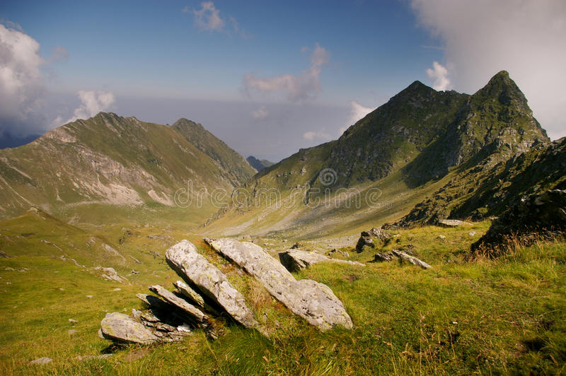 Mountain valley on summer day in wilderness stock images