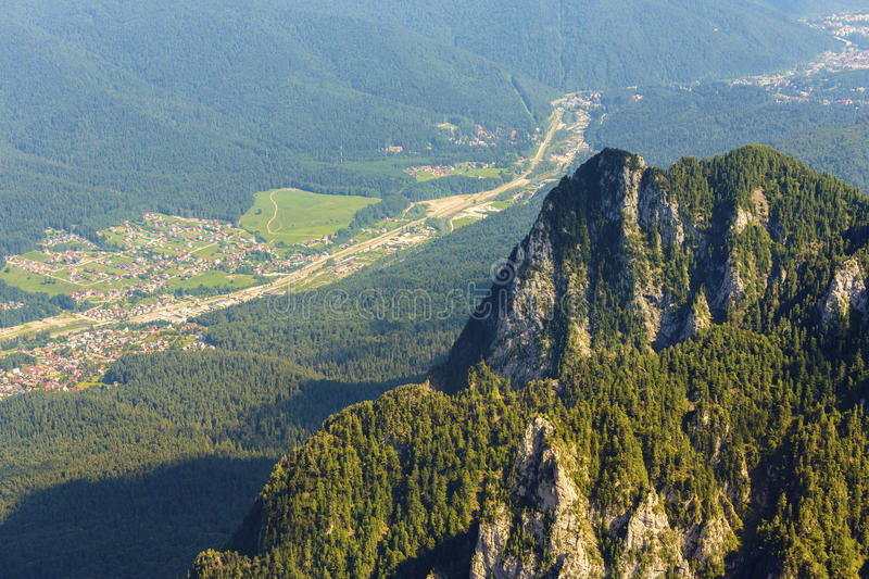 Mountain valley upper view. Rocky ridge and upper view of Prahova Valley at the base of Bucegi Mountains, Romania stock images