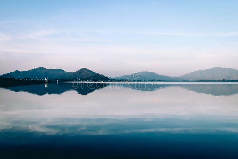 Mountain view in calm morning at the reservoir stock photos