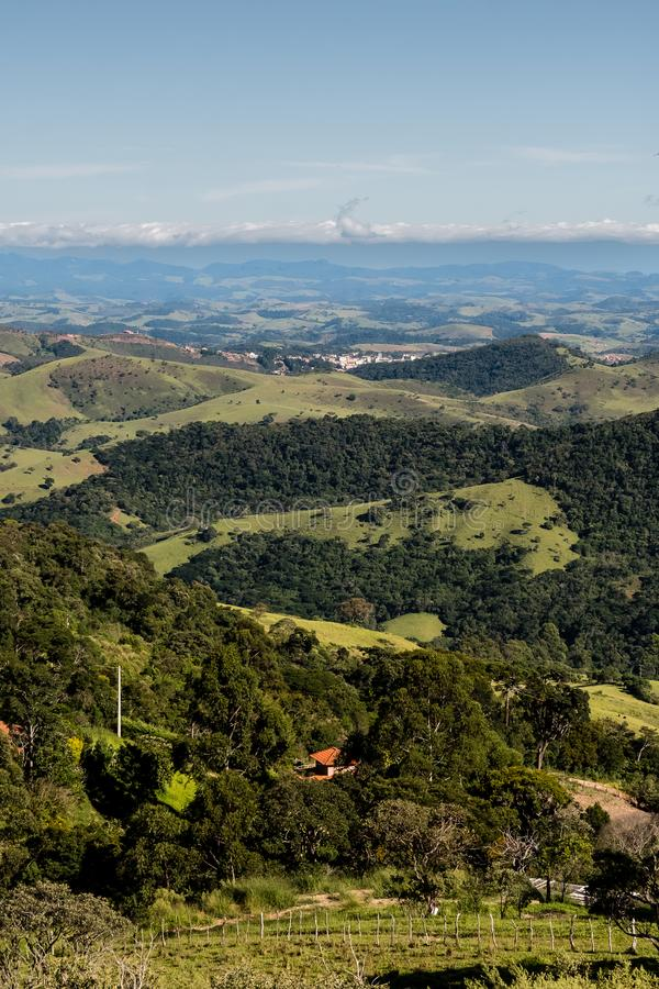 Mountain view from farm in Cunha, Sao Paulo. Mountain range in t. He background with green hills royalty free stock images