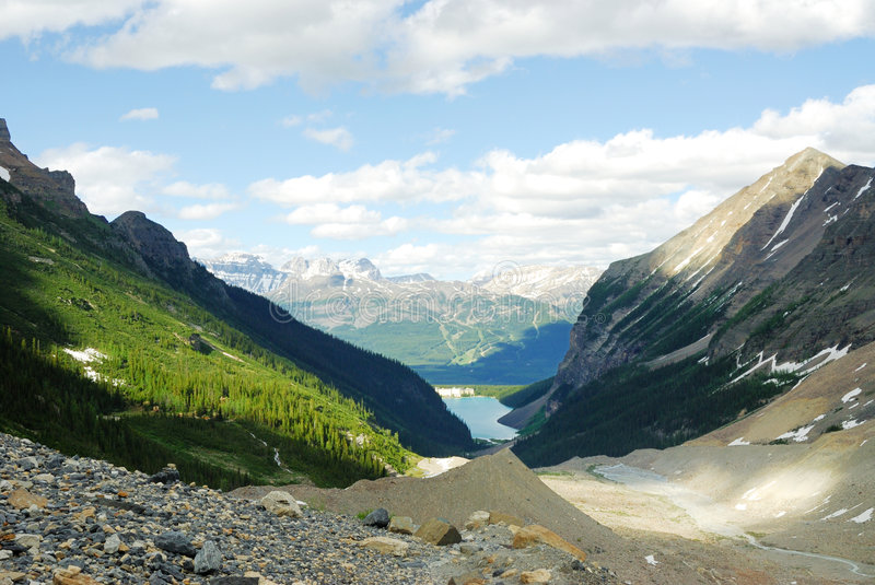 Mountain view in lake louise. View of rocky mountains when hiking in the lake louise trail, banff national park, alberta, canada stock photography