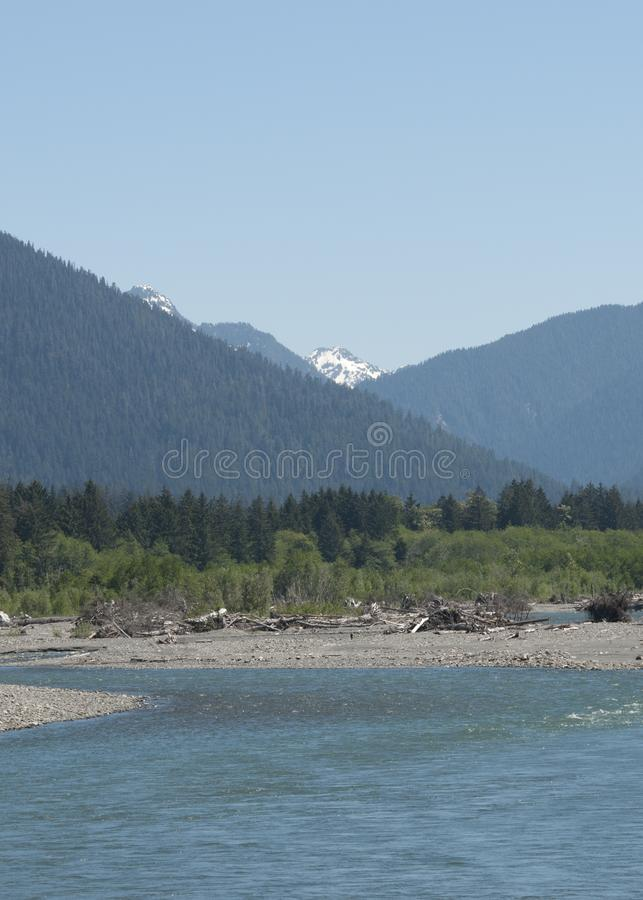 View of Snow Covered Mount Olympus with Estuary. Mountain view of Mt. Olympus, Olympic Peninsula, Washington State, United States. Estuary that leads to Pacific royalty free stock photo