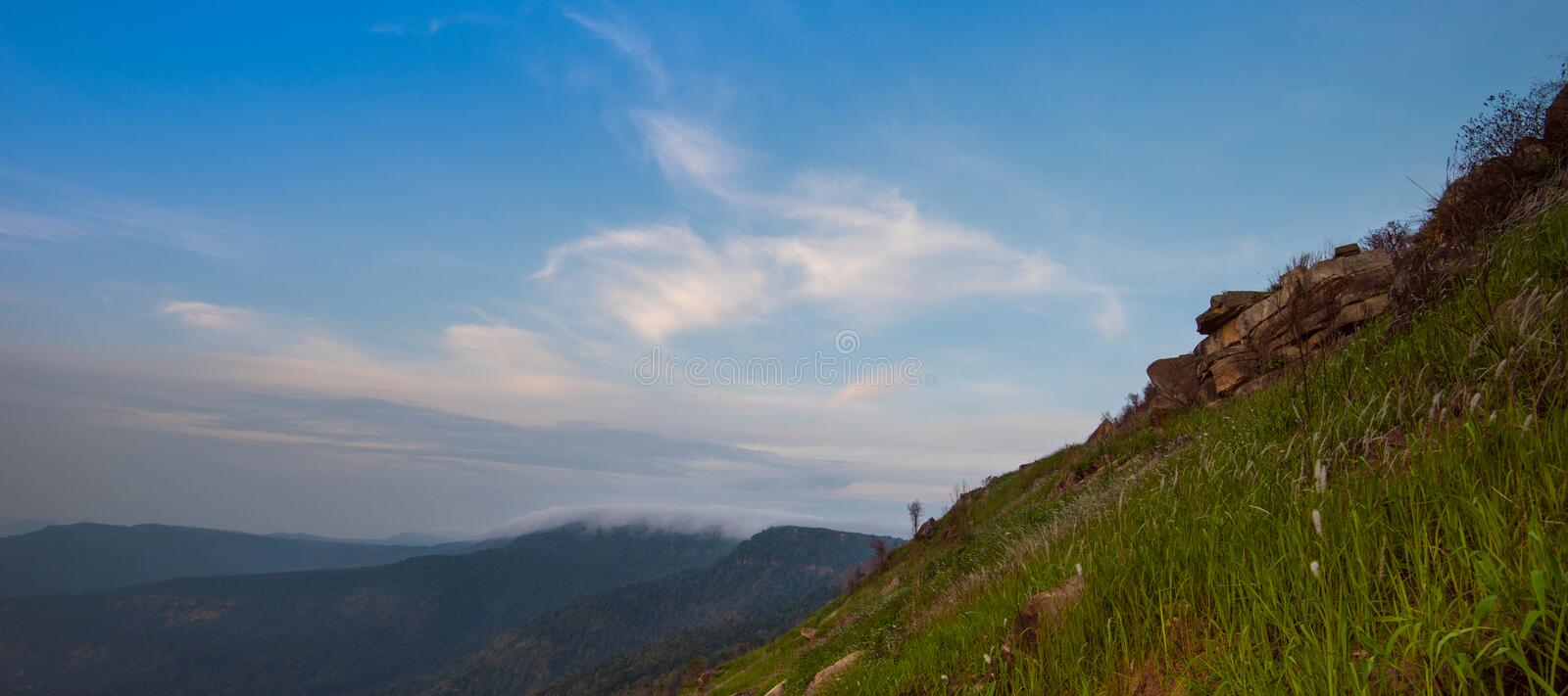 Mountain view. Mountain panorama with blue sky and clouds royalty free stock image