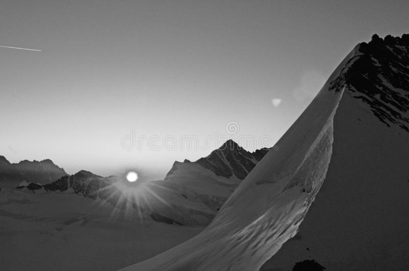 Mountain view Panorama to Jungfrau Joch from Mönchshut in the swiss alps at sunrise royalty-vrije stock afbeeldingen