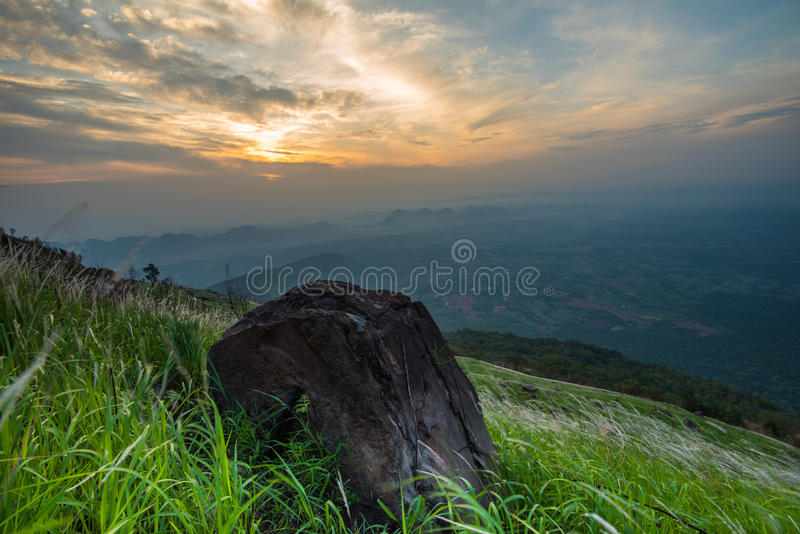 Mountain view. With stone and beautiful sky and clouds royalty free stock image