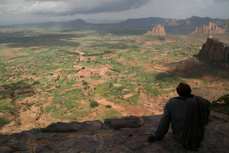 Mountain view in Tigray. A pilgrim rests after visiting Daniel Korkor church, one of the rock-hewn medieval churches in Tigray, North-East Ethiopia stock photos