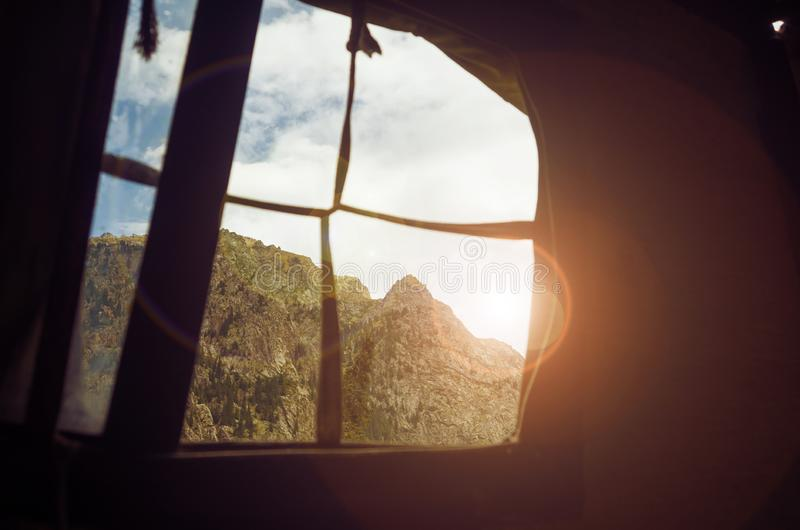 Mountain view through the window of a tent royalty free stock photo