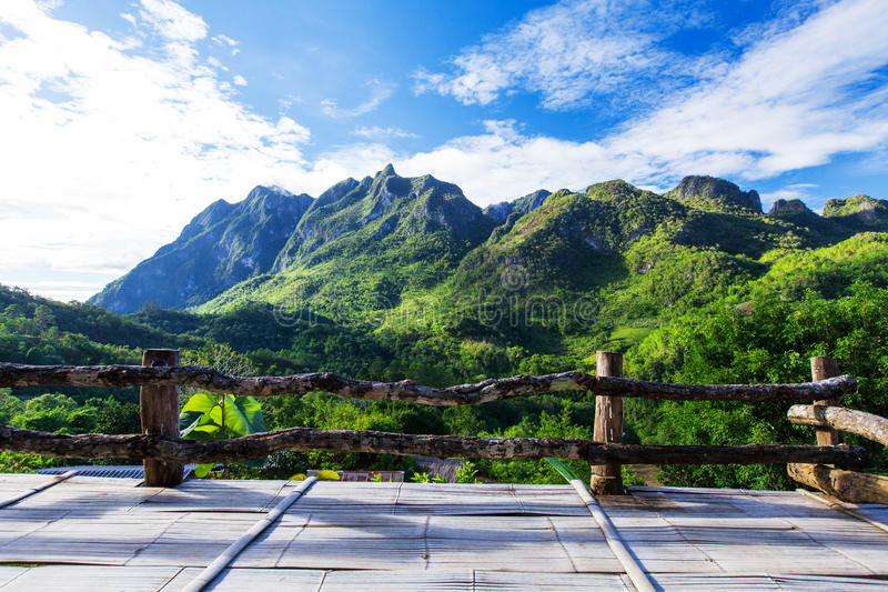 Mountain view from wooden balcony stock images