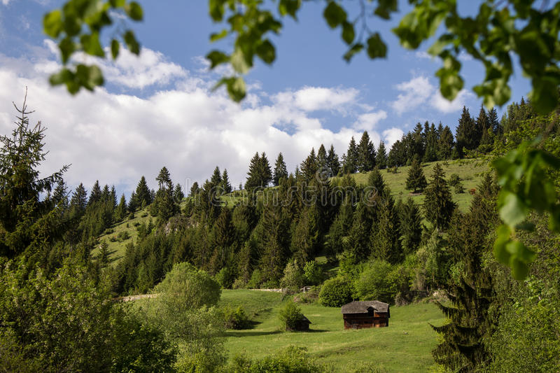 Mountain view with wooden hut royalty free stock images