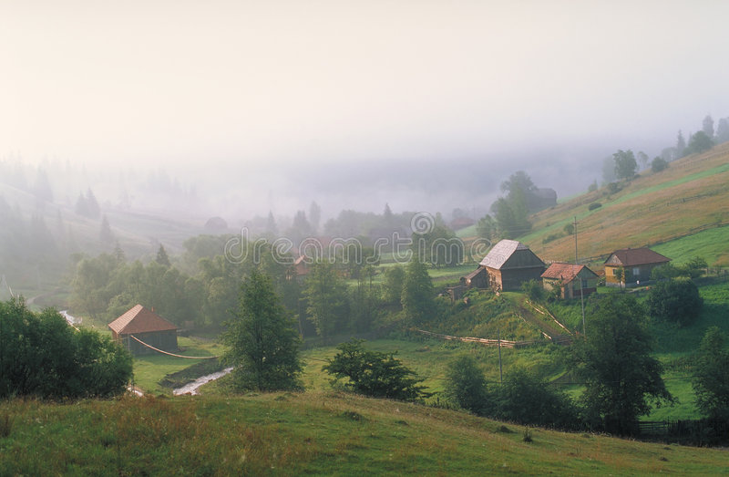 Mountain village. Carpathian village, Eastern Carpathians, Romania stock photos