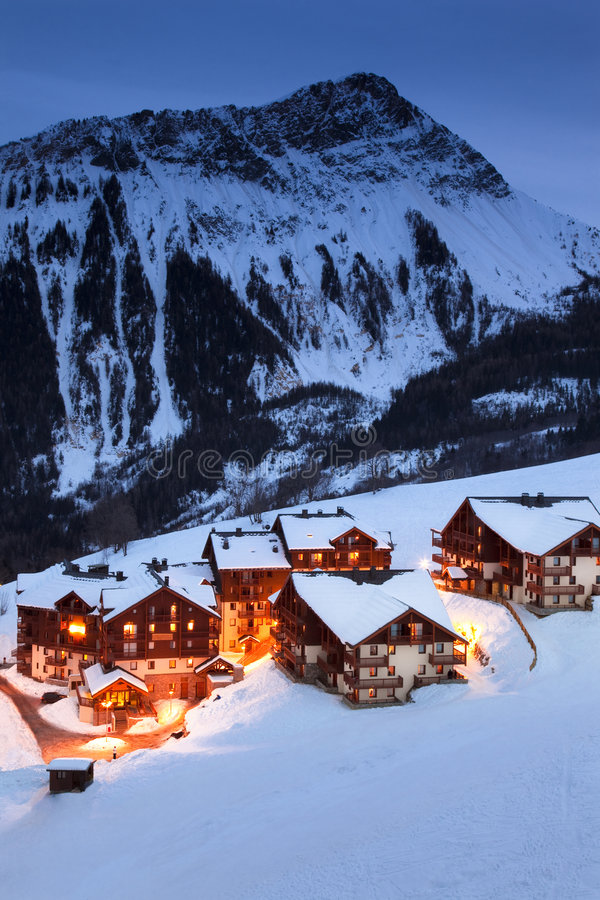 Mountain village. Illuminated french mountain village in the evening royalty free stock photography