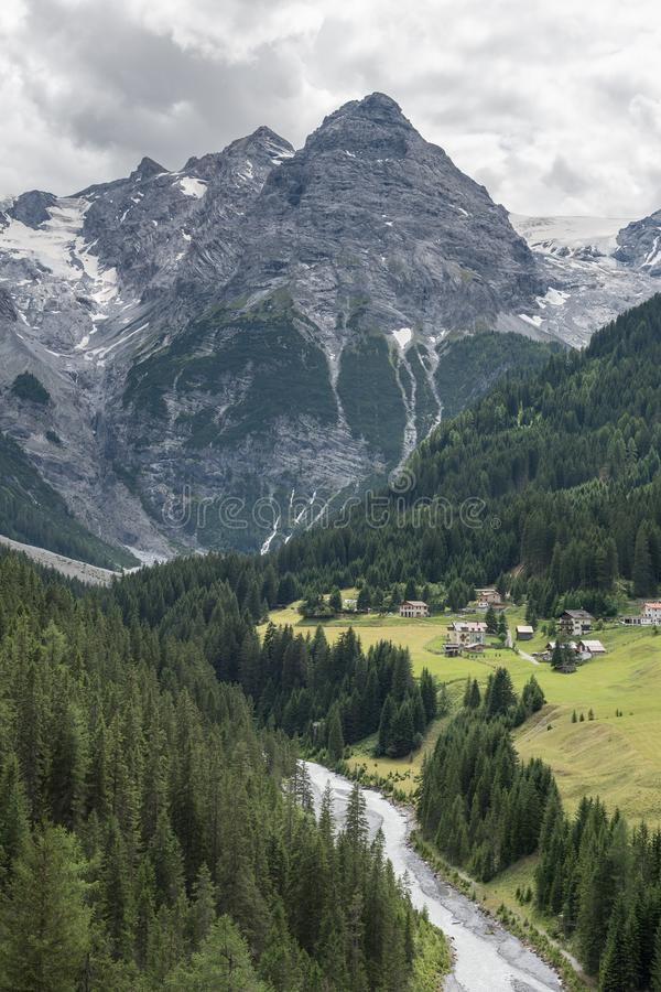Mountain Village by the River and Forest stock image