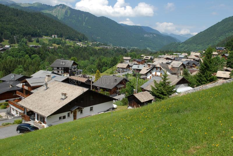 Village of Morzine in the French Alps. Mountain village in a valley with its wooden chalets stock photo