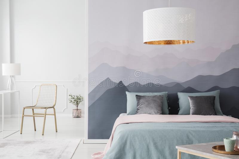 Mountain wallpaper in bedroom interior royalty free stock images