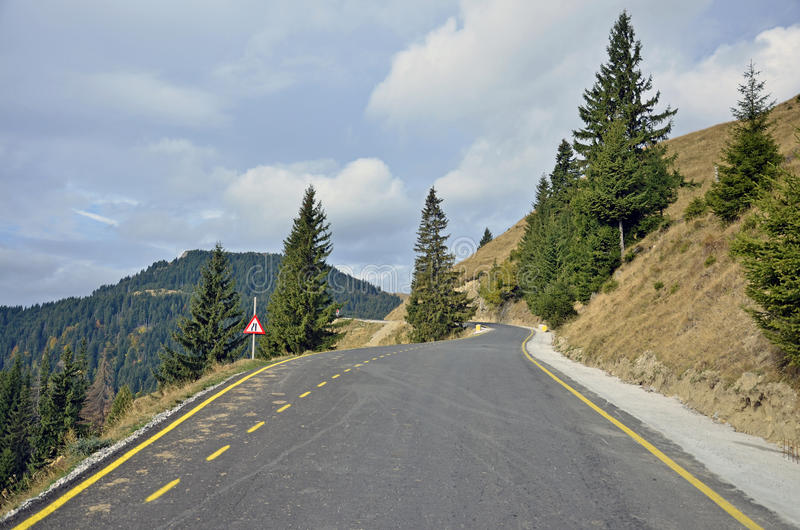 Mountain way. Curved road recently constructed to Padina, Bolboci, Pestera chalets in Bucegi mountains near Bucharest, Sinaia, Ploiesti and Brasov city in stock photo