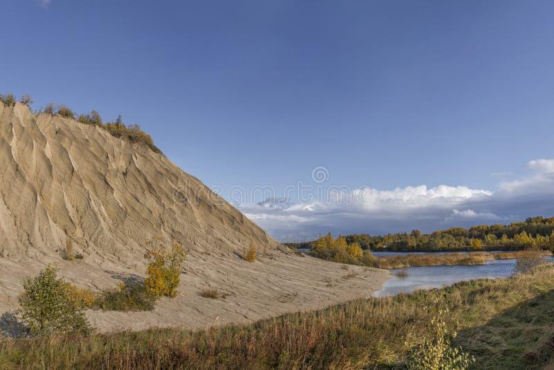 Mountain of white sand. A white mountain of white stones in Rummu Vasalema Estonia. royalty free stock photography