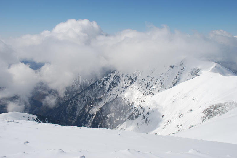 Download Mountain Winter Slope In Clouds. Royalty Free Stock Photos - Image: 14702618
