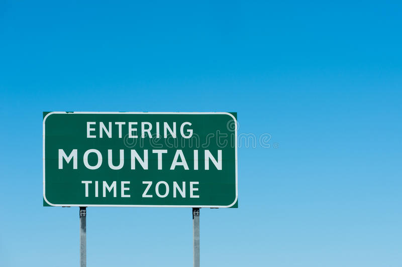 Mountain zone. Road sign with Mountain time zone, New Mexico stock images