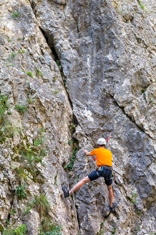 Mountaineer climbing Sohodol Gorges rocky slopes royalty free stock photography