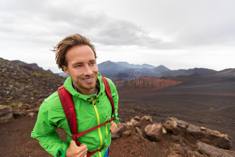 Mountaineer hiker man walking on mountain trail hike in Maui Haleakala crater volcano, Hawaii travel lifestyle stock photography
