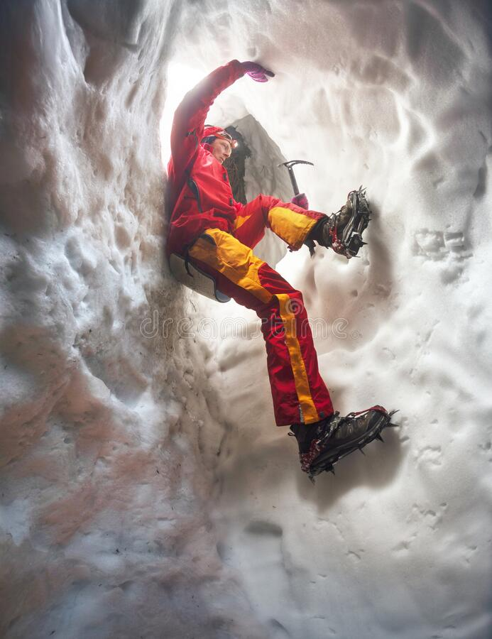 Free Mountaineer In Snow Cave Stock Photography - 213199092