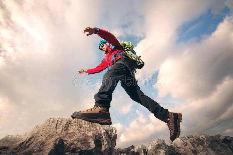 Mountaineer jumps stock photo