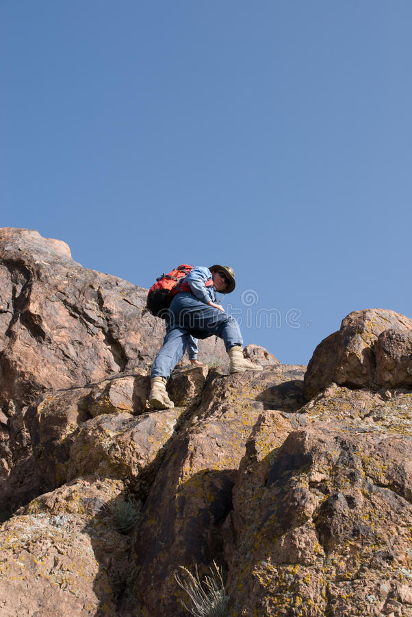Mountaineer looking down stock images