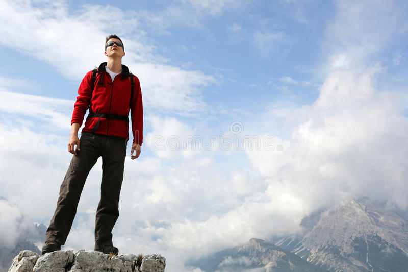 Mountaineer on mountain top in the mountains royalty free stock photo