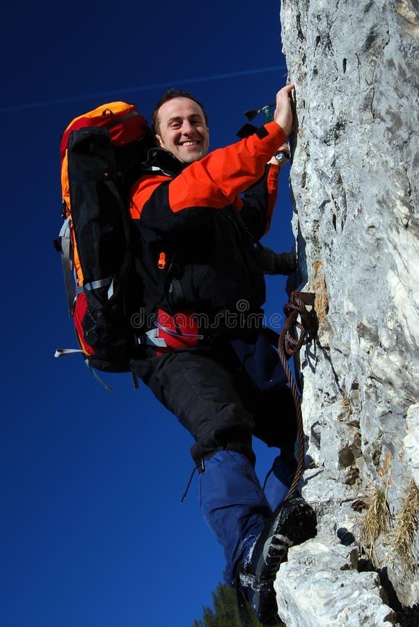Mountaineer rock climbing stock images