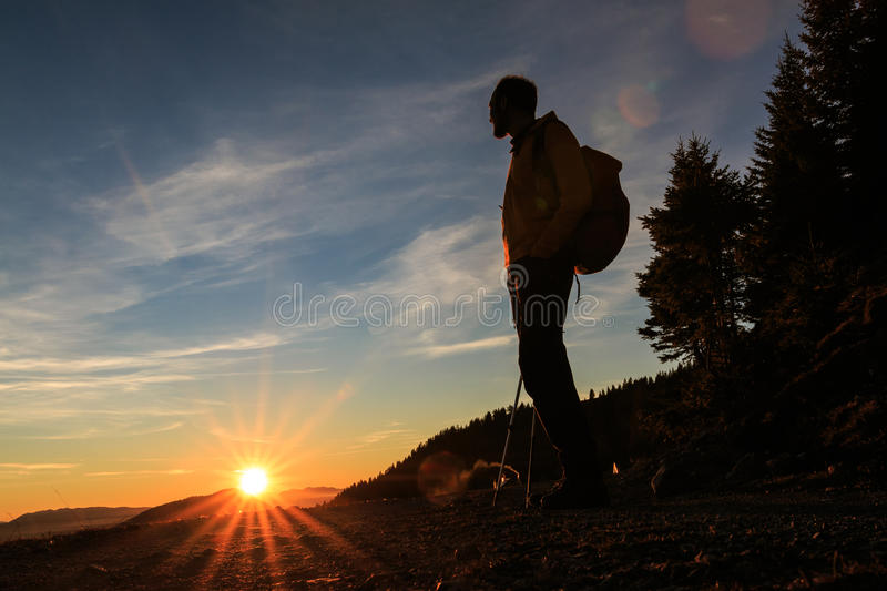 Mountaineer silhouette at the sunset royalty free stock images