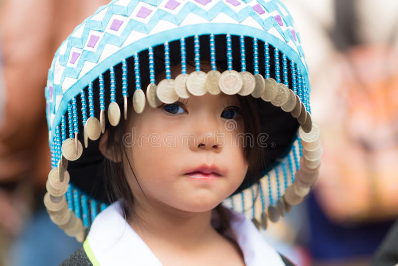 Mountaineer tribe. Luang Prabang, Laos - December 20, 2015: A little girl of local mountaineer tribe 'Hmong' is dressing with traditional costume in Luang royalty free stock image