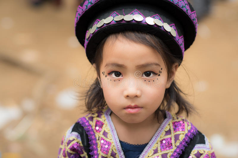 Mountaineer tribe. Luang Prabang, Laos - December 20, 2015: A little girl of local mountaineer tribe 'Hmong' is dressing with traditional costume in Luang stock image