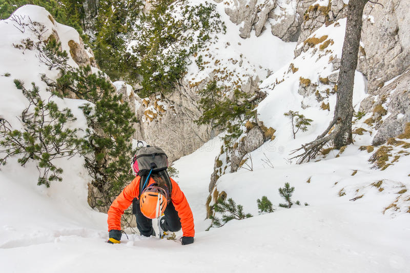 Mountaineer woman descending a gully royalty free stock photography