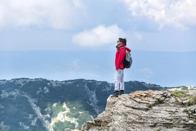 Mountaineer woman in Pirin mountain. Mountaineer woman on top of Pirin mountain ,Vihren peak,Bulgaria royalty free stock photography